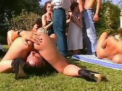 Numerous people fuck and cum on grass