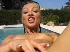 Yummy blonde sensually sucking cock near the pool