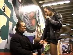 Filthy whore in leather jacket blows guy in subway