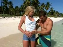 Yummy blonde sensually sucking stiff cock on beach