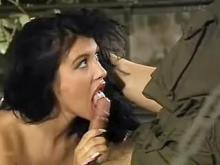 Lewd brunette making sensual blowjob military man