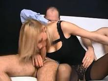 Depraved blond floozie sucks two cocks of lewd men