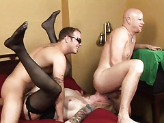 Tattooed shemale beeing fucked in group by 2 massive and aroused cocks