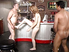 She takes on 2 men in a game of dicks and balls domination !