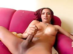 Kinky Alana Ferreira gently stokes her massive prick.