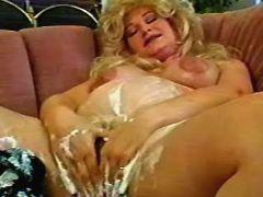 Pregnant milf has fun with cream