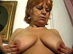 Old woman enjoying dildos