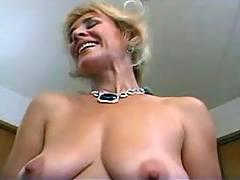 Granny plays with dildo