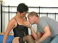 Brunette milf enjoys oral