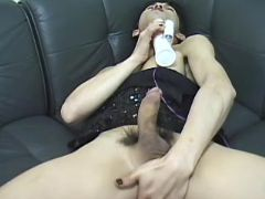 Shemale plays with dildo