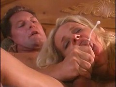 Hot blonde gets milky facial on bed