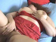 Curly plump lady in red masturbates