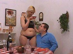 Sensual greasy woman blowing hard dick on sofa