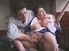 Enormous Asian lady enjoys vibrator on sofa