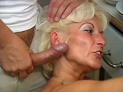 Old woman has fun with guys in orgy