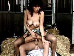 Dirty milf vixen fucking with jockey in barn