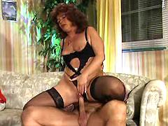 This retro lady in black stockings wants big cock
