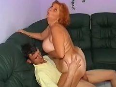 Redhead granny sucks and rides cock