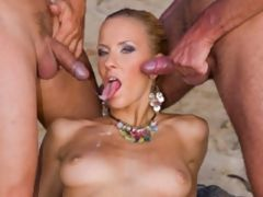 Nasty blond fucked by three guys on the beach