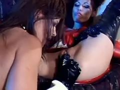 Hot lesbians in latex enjoy sextoys