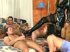 Three latex whores orgy
