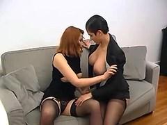 Lesbian couple sucks cock