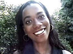 Ebony rubs clit outdoors