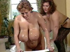 Busty babes play in bath