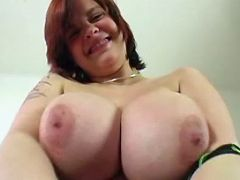 Redhead shows huge boobs