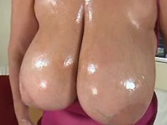 Milf plays with huge bobs