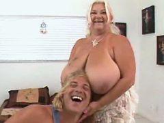 Chubby mom plays with boy