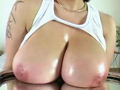 Busty babe shows big tits