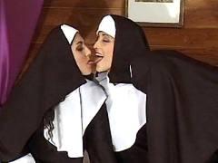 Nuns caress each other