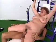 Busty grandma fucks in gym